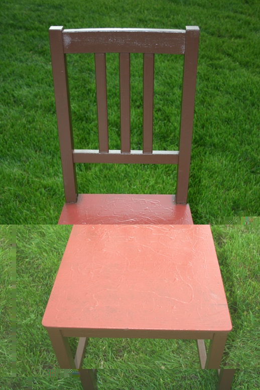 a chair painted brown and dark red