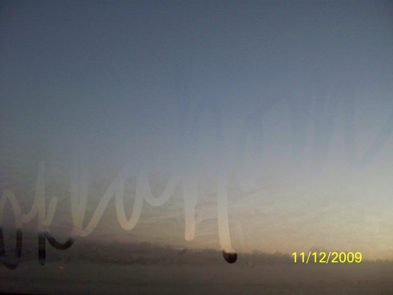 a photo of 'oklahoma' written in condensation of auto window
